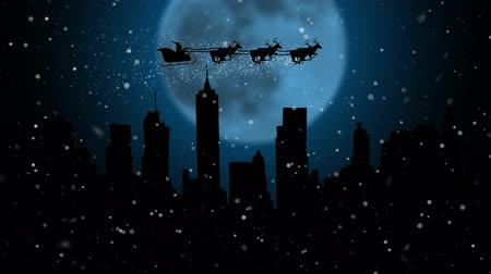 new town : Santa Claus and his deer flying in the sky merry chrisrmas animation . Silhouette