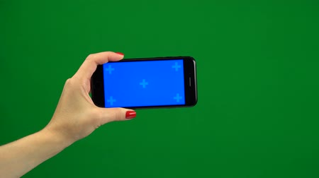 technics : Phone screen is blue chroma key. Green screen Stock Footage