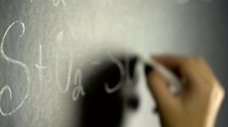 şematik : Woman writing chemistry formula on black board
