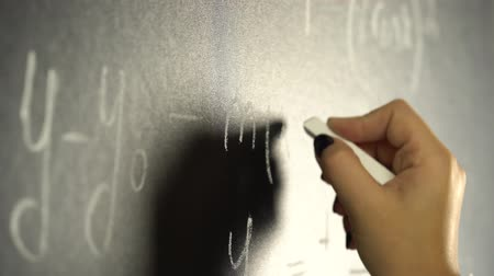 písanka : Hand is writing with a chalk a mathematical of a formula on a blackboard