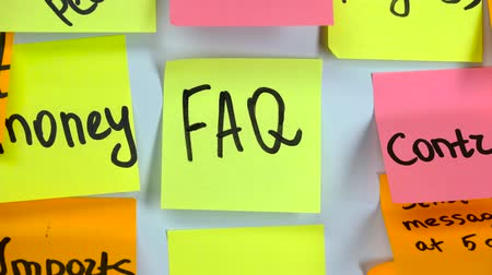 clipe de papel : Sticker with the word FAQ stick on a white board