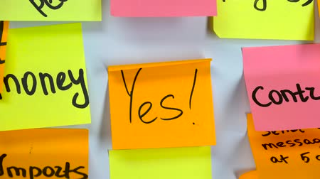 poczta : Sticker with the word yes stick on a white board
