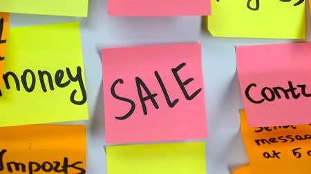 reminder : Sticker with the words sale on a board Stock Footage