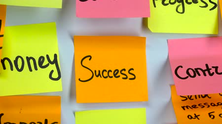минус : Sticker with the words success on a board Стоковые видеозаписи