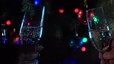 sektglas : Celebration with two clinking champagne glasses. Slow motion. Close up