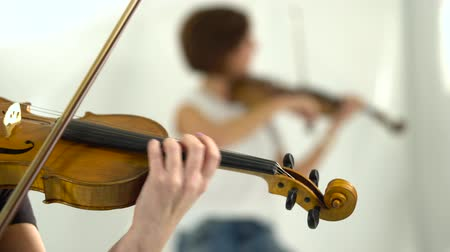 szakadt : Violin playing closeup blurred background