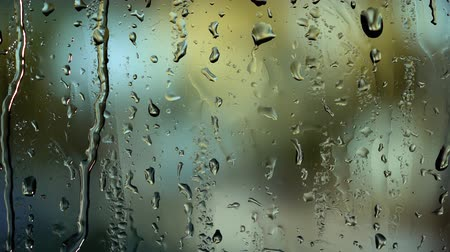 Abstract background with view through cafe window in rainy day on city street