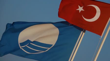 hilâl : Flag of Turkey waving in the wind blue sky on background. Slow motion