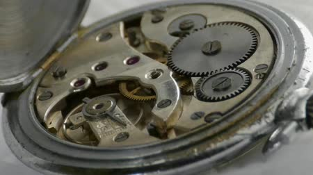 industrialization : Clockwork movement of a pocket watch Stock Footage