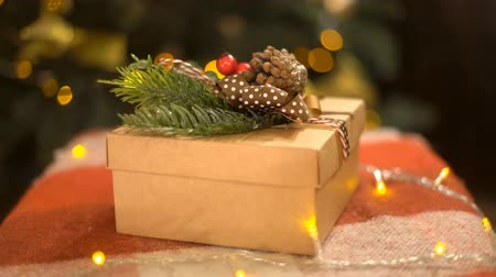 önemsiz şey : Christmas And New Year Gift Box Closeup Near Decorated Christmas Tree. Stok Video