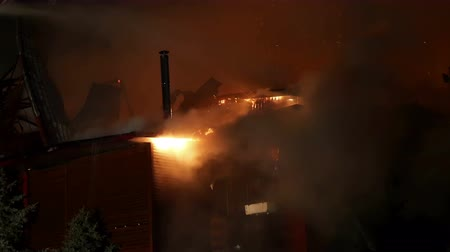 building heat : House building on fire at night. Inferno conflagration.