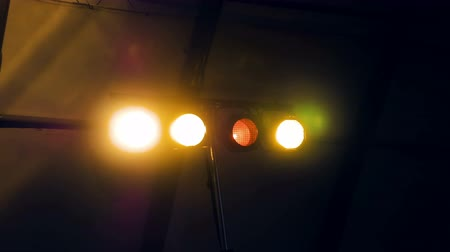 více barevné : Flashing lights in a dark room. These lights are mostly seen in clubs, discos or parties. Flashing lights makes the surrounding more fun.