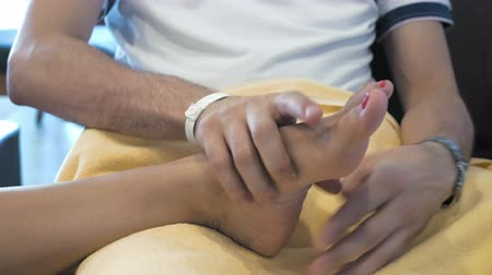 male : A man is showing a kind gesture by massaging someones foot. Massage is great way to feel relaxed. Massaging involves applying pressure.