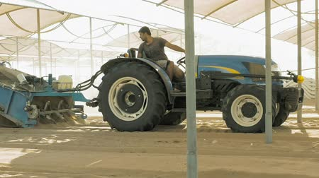 sieving : Side, Turkey - July 02, 2016: A man is driving a tractor on an empty beach filled with sand. Sieving the beach sand make it ready to people recreation on it. Good infrastructure assure good pleasure