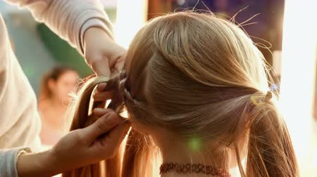 головной убор : Female model getting her hair dressed before an event. Makeup appearance and hairstyle are important for every beautiful woman. Стоковые видеозаписи