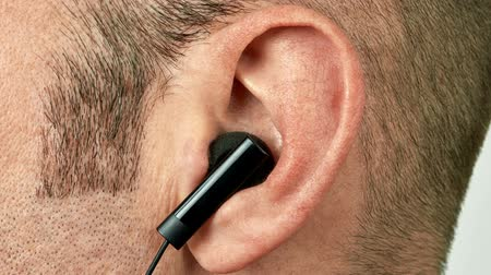 earlobe : Ear with black earphone dancing vibrating and jumping to the music Stock Footage