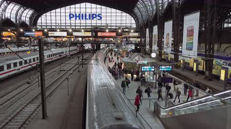 train station : Berlin, Germany - October, 9, 2016: Railway station terminal in Berlin Germany with passengers on platform waiting for train. Big city transportation in Europe