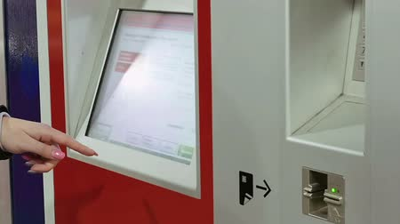 vending machine : Ticket machine in metro subway underground tube is being used by young lady. Woman buys tickets at public transportation station self service ticket machine. Stock Footage