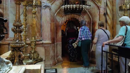 dolorosa : Jerusalem, Israel - May 25, 2017: People are entering into Jesus Empty tomb in Jerusalem in the Holy Sepulcher Church. The Church and Empty Tomb the most sacred places for all Christians in the world.