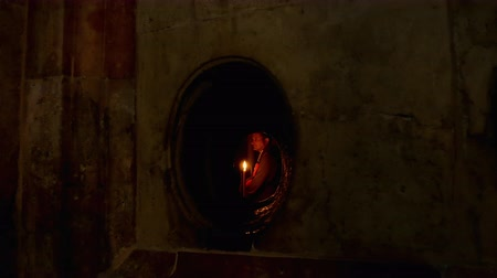 dolorosa : Jerusalem, Israel - May 25, 2017: People in the Jesus Empty tomb in Jerusalem in the Holy Sepulcher Church. View through window. The Church and Empty Tomb the most sacred places for all Christians.