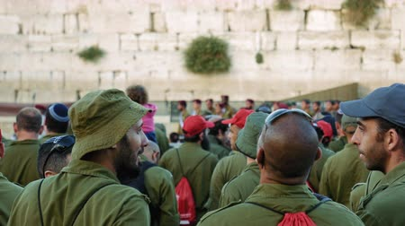 idf : Jerusalem, Israel - May 25, 2017: Israeli soldiers and military men in the crowd near the Western Wall in Jerusalem. Western wall or Wailing wall or Kotel is the most sacred place for all jews.