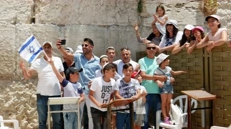 israelite : Jerusalem, Israel - May 25, 2017: Israeli family is singing and being happy celebrating the Jerusalem Day near Western Wall (Wailing Wall or Kotel) the most sacred place for all jews on the planet. Stock Footage