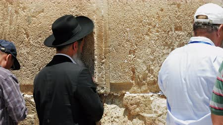 israelite : Jerusalem, Israel - May 25, 2017: Jew haredi pray at the Western Wall also known as Wailing Wall or Kotel in Jerusalem. The Western Wall is the most sacred place for all jews and jewish in the world.