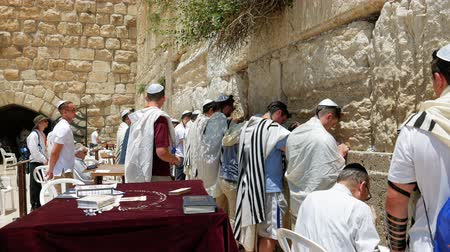 israelite : Jerusalem, Israel - May 25, 2017: Western Wall or Wailing Wall or Kotel in Jerusalem. People come to pray to the Jerusalem western wall. The Wall is the most sacred place for all jews in the world. Stock Footage