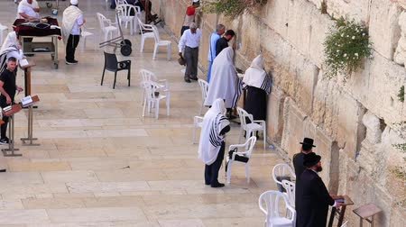 wailing : Jerusalem, Israel - May 21, 2017: Western Wall or Wailing Wall or Kotel in Jerusalem. People come to pray to the Jerusalem western wall. The Wall is the most sacred place for all jews in the world.