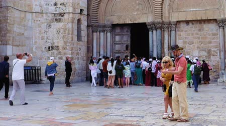 dolorosa : Jerusalem, Israel - May 25, 2017: Entrance of the Holy Sepulcher Church in Jerusalem. The Holy Sepulchre Church and Empty Tomb the most sacred places for all religious Christians in the world.