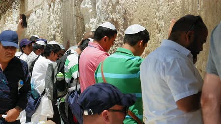 zsidó : Jerusalem, Israel - May 25, 2017: Western Wall or Wailing Wall or Kotel in Jerusalem. People come to pray to the Jerusalem western wall. The Wall is the most sacred place for all jews in the world. Stock mozgókép