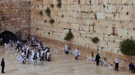 israelite : Western Wall or Wailing Wall or Kotel in Jerusalem. People come to pray to the Jerusalem western wall. The Wall is the most sacred place for all jews in the world.