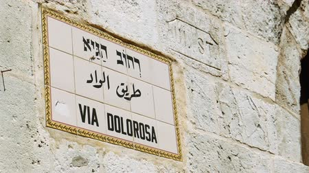 dolorosa : Via Dolorosa street sign in Jerusalem old city. Via Dolorosa is a sacred place for the all Christians in the world. Located in Holy land Jerusalem. Zoom shot. Stock Footage