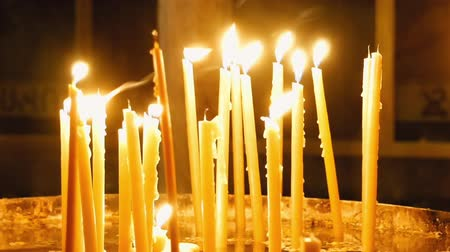 dolorosa : Burning candles in the Holy Sepulcher Church in Jerusalem. The Holy Sepulchre Church and Empty Tomb the most sacred places for all religious Christians in the world. Stock Footage