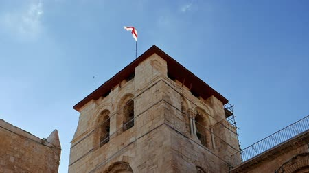 dolorosa : Roof of the Holy Sepulcher Church in Jerusalem with flying flag. The Holy Sepulchre Church and Empty Tomb the most sacred places for all religious Christians in the world. Calvary also located there.