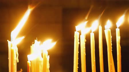 christening : Burning candles. Celebration event or religious memorial attribute of warmth and sincerity. Stock Footage