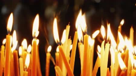 gyertyák : Burning candles. Celebration event or religious memorial attribute of warmth and sincerity. Stock mozgókép