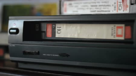 выброс : VHS cassette ejecting from video cassette recorder. Стоковые видеозаписи
