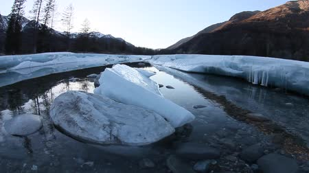 alasca : melting glacier on the river in the spring in the mountains