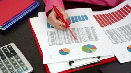 financial : woman considering financial report Stock Footage