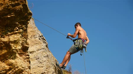 odwaga : Climber Descends On A Rope
