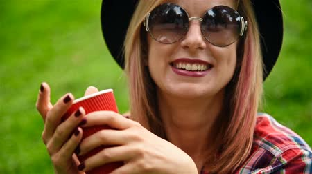 model s : Happy Hipster Girl With Red Cup Of Coffee. Close Up Stock Footage