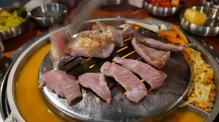grilling : 4K Video of delicious Korean style Barbecue Pork meat ate at Kang Hodong Baekjeong, Los Angeles, California