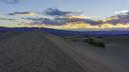 stovepipe wells : The Mesquite Flat Dunes and sunrise timelapse at Stovepipe Wells, Death Valley National Park Stock Footage