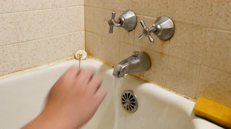 tuvalet : Man hand closes a water tap in bathroom