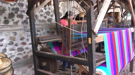 cdmx : Teotihuacan, FEB 17: Woman weaving cotton in an old traditioan machine on FEB 17, 2017 at Teotihuacan, Mexico Stock Footage