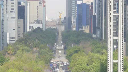 cdmx : The historical The Angel of Independence  (El Angel de la Independencia), Paseo de la Reforma and the surrounding buildings of Mexico City, Mexico