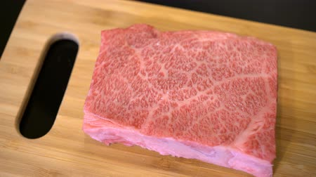 wagyu : Delicious 4K video of preparing and salting Wagyu Beef steak at home Stock Footage