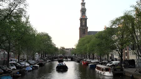 amsterodam : Afternoon view of beautiful canal of Amsterdam city and the historical Westertoren church, Netherlands