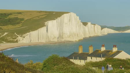 yedi : Motion Timelapse of the famous landscape, Seven Sisters Cliffs with Coastguard Cottages at West Sussex, United Kingdom Stok Video
